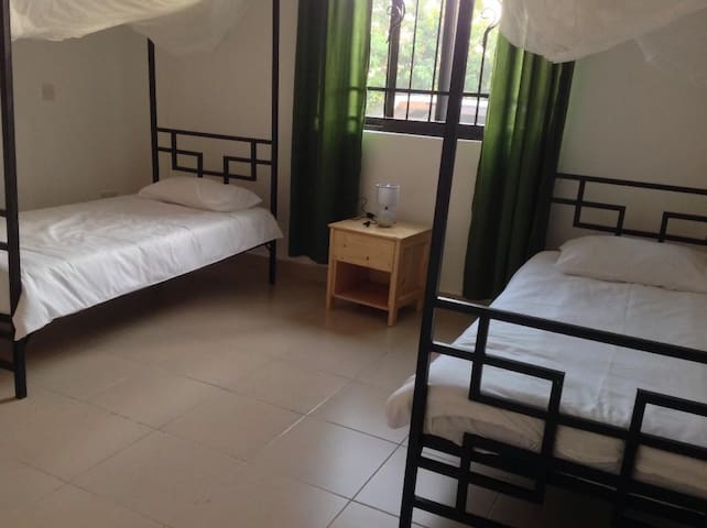 Twin room. All beds have mosquito nets and bedding.