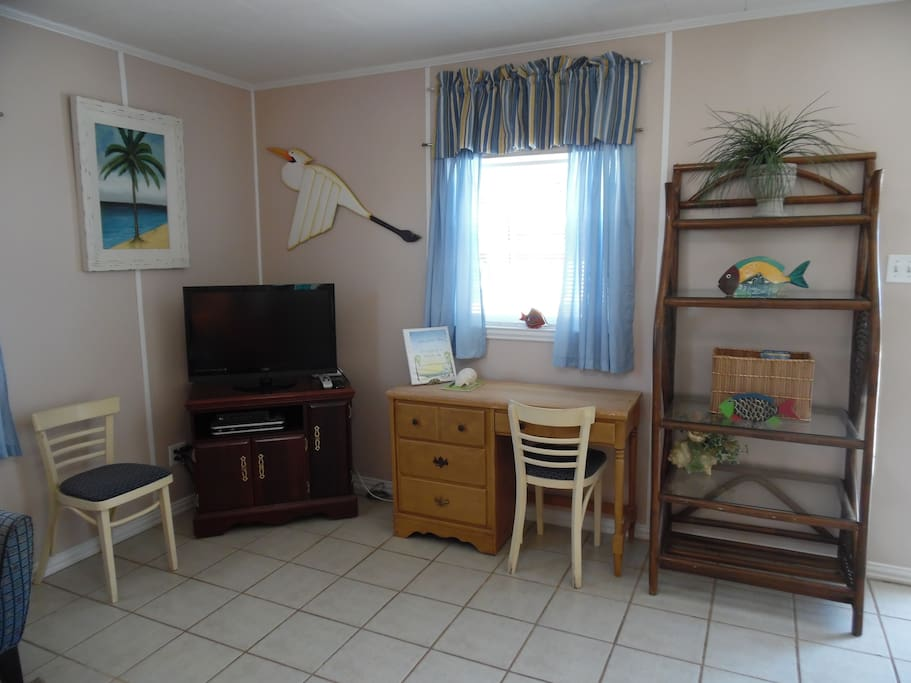 Spacious living room with desk and Direct TV. Wi-fi throughout the cottage