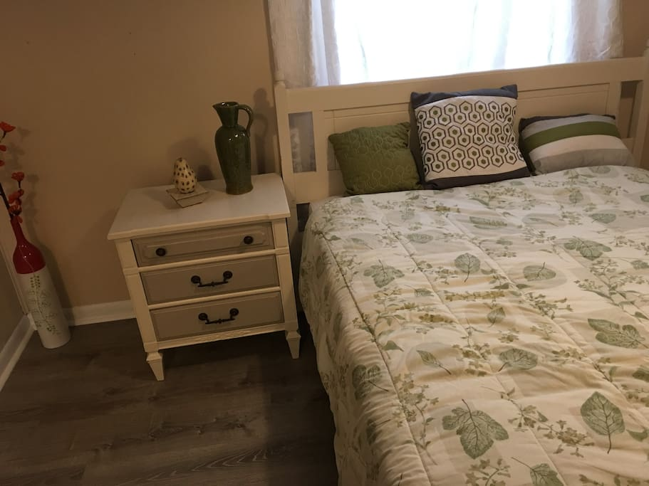 Comfortable and bright bedroom with full size bed