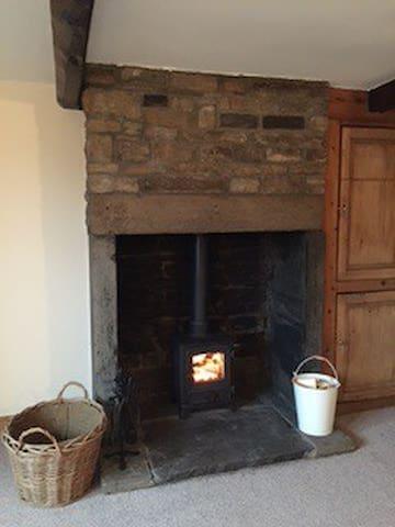 Multi-fuel stove in the original inglenook in sitting room
