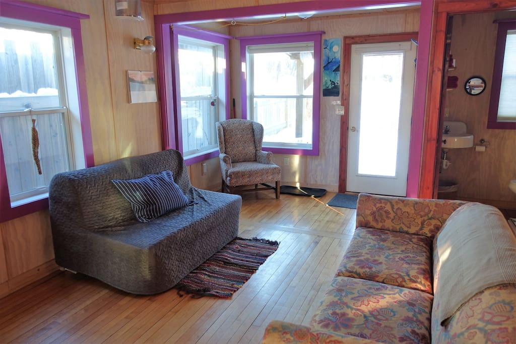 Spacious living room. Blue couch converts to a double bed.