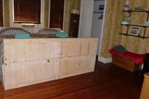 Main Room has a big closet, wicker trunk and dresser for storage.