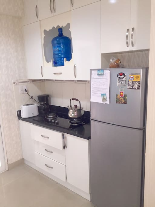 Roomy kitchen for food prep and a coffee machine as well as Vietnamese coffee equipment.