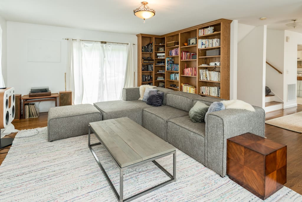 The living room has a HUGE sofa and built-in bookcase—home to the movie projector and tons of reading.