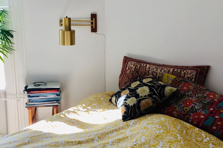 bedroom in a cosy, bright Boho apartment