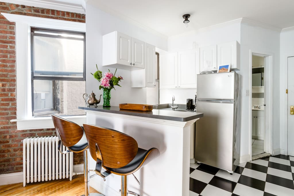 An eat-in kitchen with comfy and stylish seating