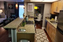 Fully equipped kitchen with breakfast bar; espresso and  capuchino coffee maker;