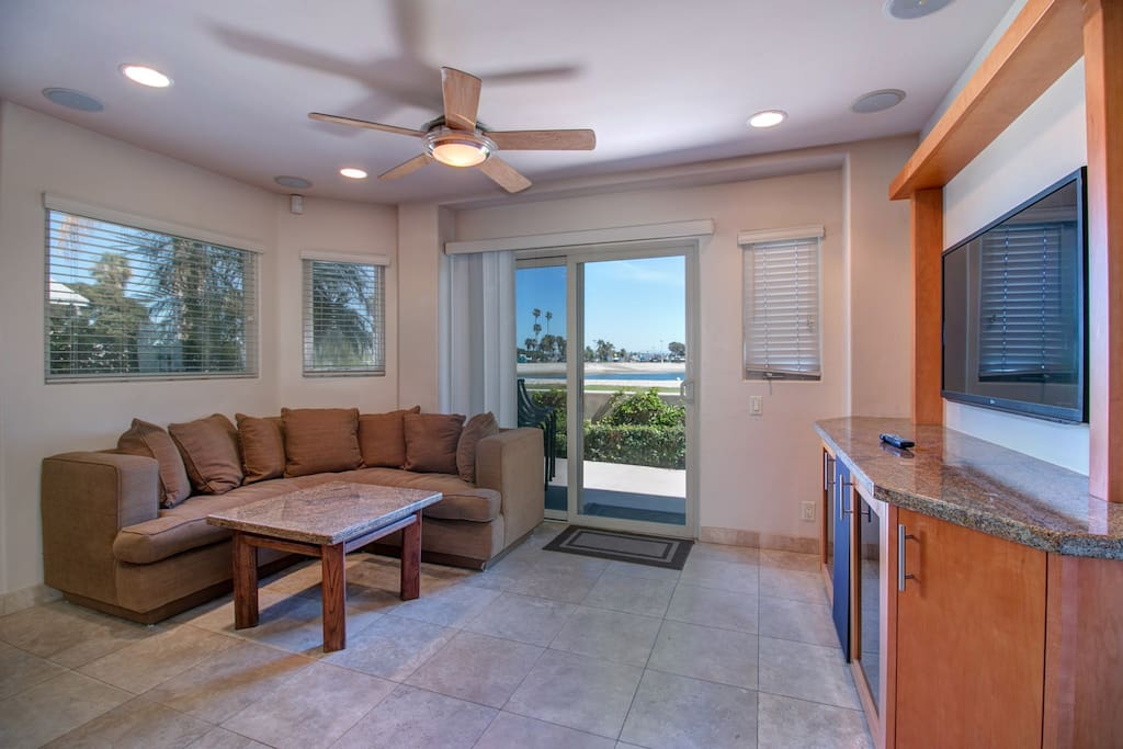 Living area with patio doors and views out onto your own private patio and access onto the boardwalk