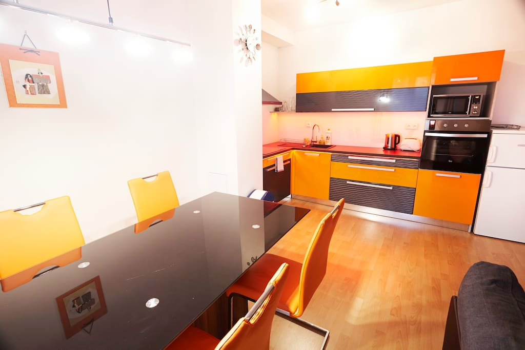 Large glass dinning table and full equipped kitchen