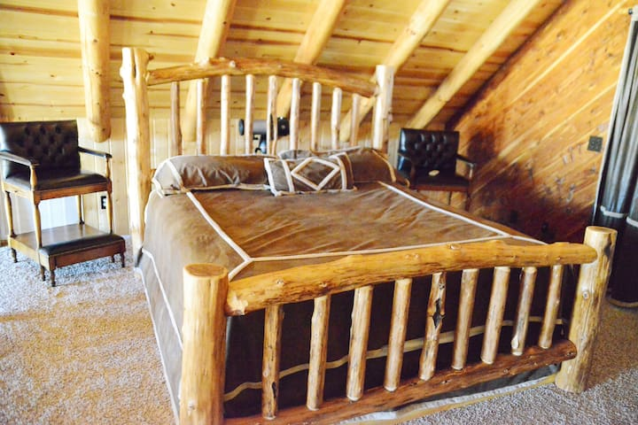 Hand turned king size bed in loft - with a great view!
