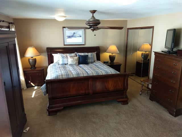 Master bedroom with king bed and on suite bathroom.