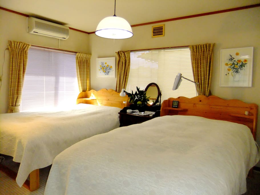 Bedroom 1, with 2 reduced-size double beds. セミダブルベットが2つ。