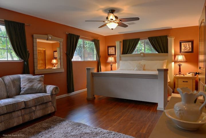 Chardonnay Suite can sleep up to 4 guests with a pull out queen sofa bed.  Private bath with large shower just across hall