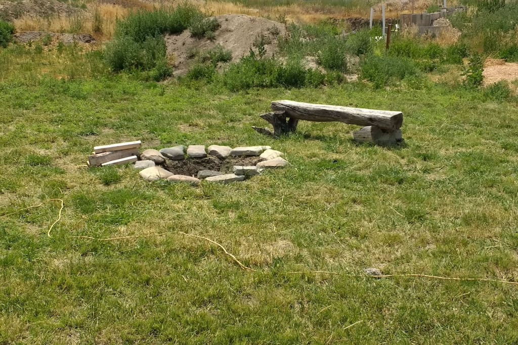 Fire pit.  Two bundles of wood are provided.