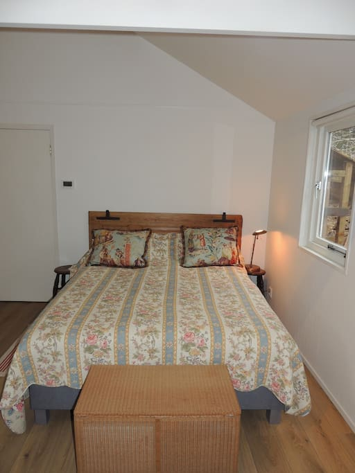 Two single beds linked to a double bed