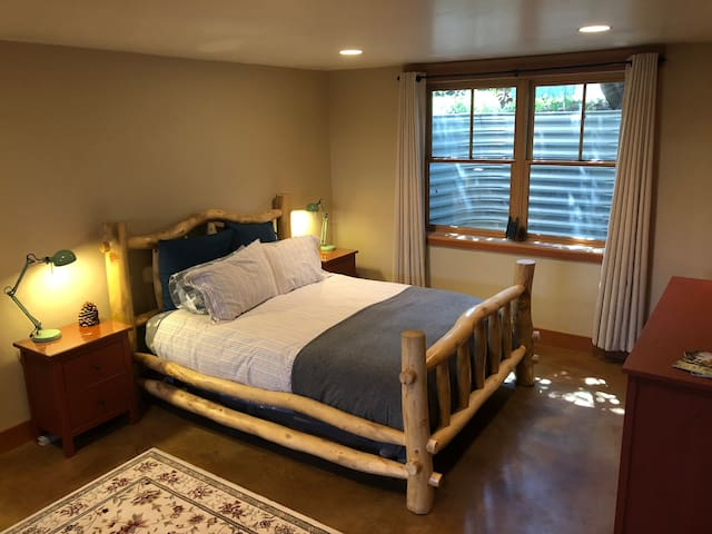Main bedroom with a very comfortable queen bed, large chest of drawers and matching nightstands. Great private space for rest and relaxation!