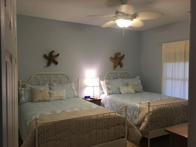 Large bedroom #1 with two full size beds. All the kids can stay in one room! No need to bring your own sheets, all linens and pillows are included.