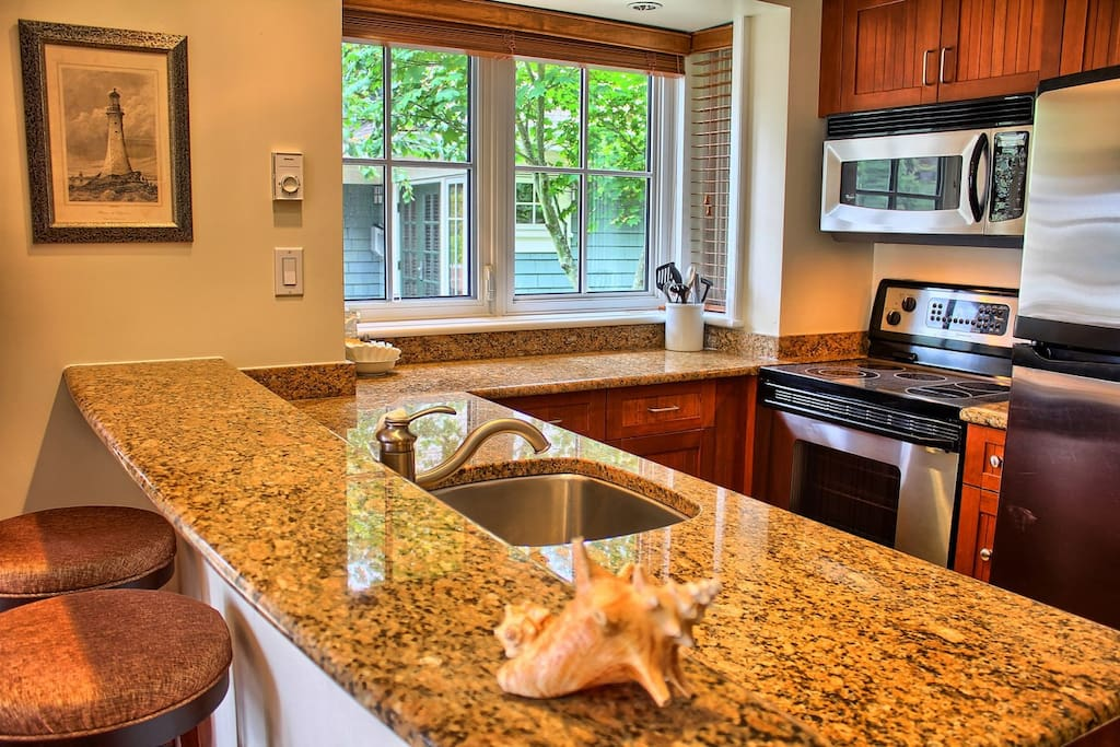 The fully-equipped kitchen includes lots of counter space and a breakfast bar