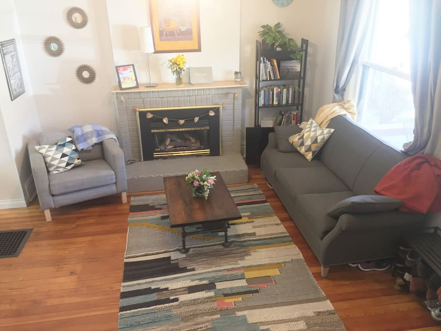 """Living room with electric fire place and 42"""" TV"""