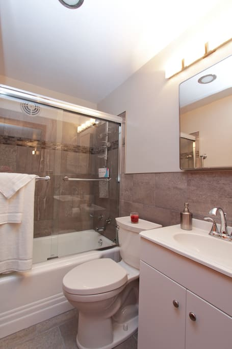 Tons of hot water, fluffy towels, body wash, shampoo & conditioner, this compact bathroom has a large medicine cabinet awaiting your personal items. Tucked under the vanity is a hair dryer & magnifying make-up mirror. Don't squeeze the Charmin!