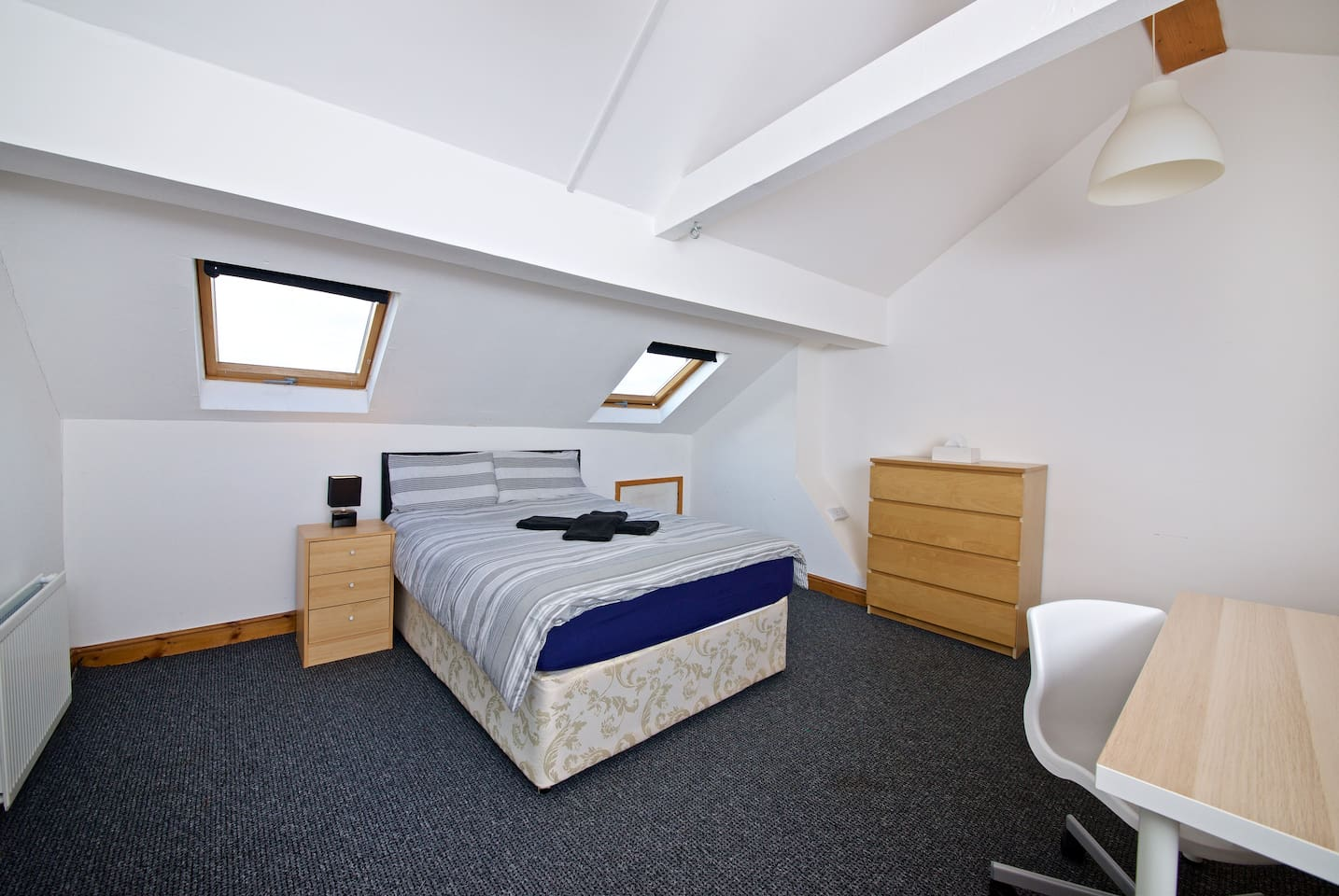 Private attic bedroom with shared bathroom, living room and kitchen. Double bed ideal for a couple or single person.  Room number B3 with Chester drawer, night table, wardrobe, table and chair. + Free towels/Shampoo/Tea/coffee/sugar/salt/pepper/oil.