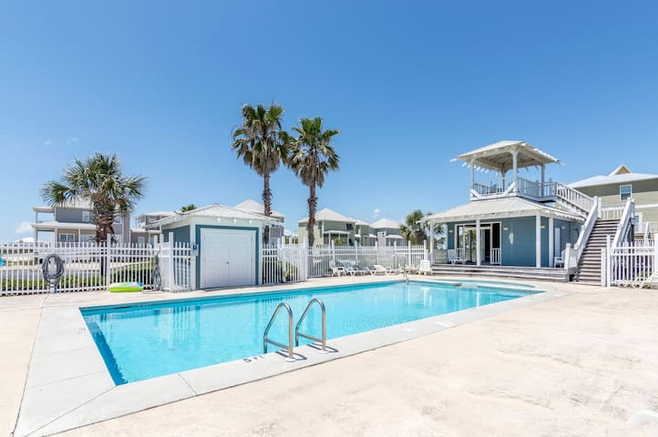 Pool is shared by the community and is a short walk past two duplex homes