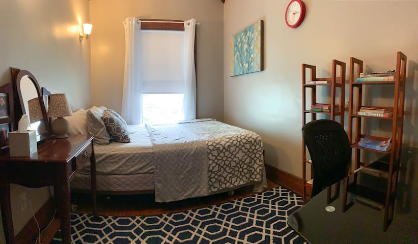 [3rd Bedroom] ...features a queen size bed, nightstand, desk, chair, and a closet.