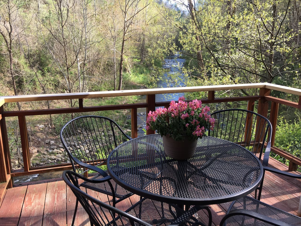 Wonderful back porch where you get lulled into relaxation with all the sounds of nature and the rushing waters