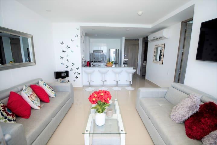 Sala con dos sofa camas