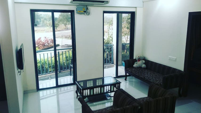 Drawing room with french windows with a patio and connected lawn to spend quality time with your dear ones
