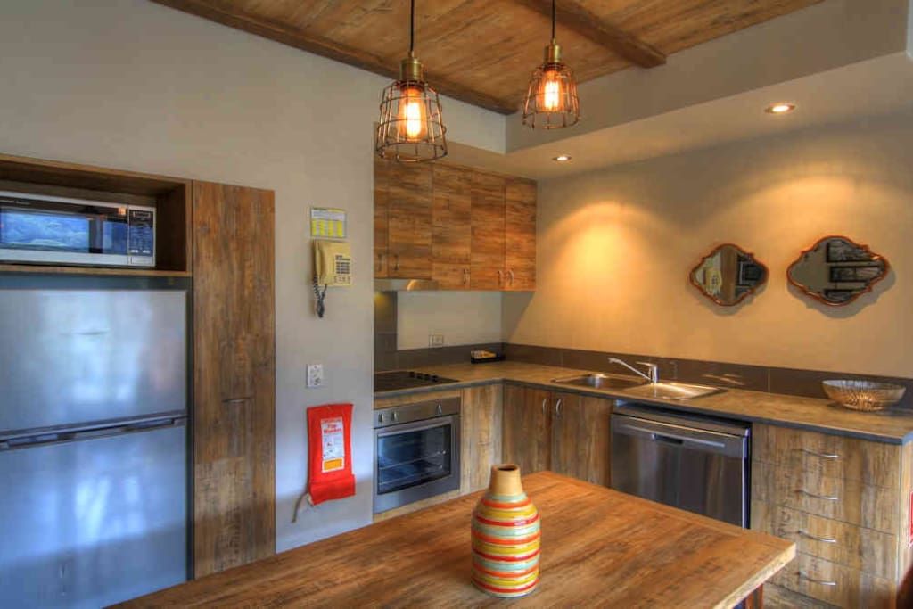 Fully  Equipped kitchen with comfortable dining setting