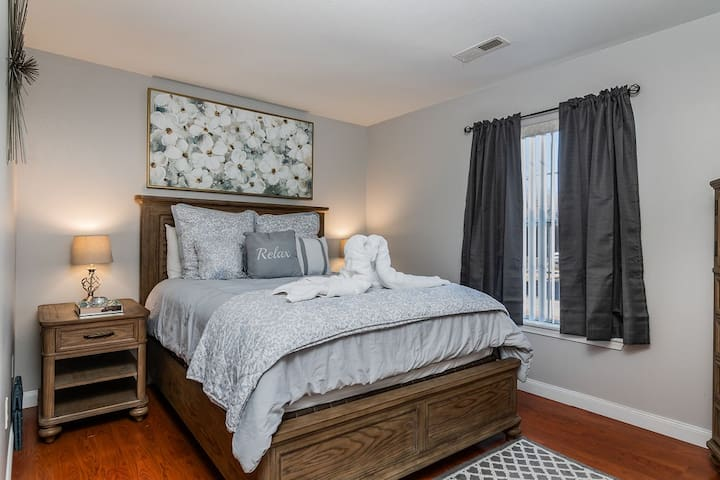 Bedroom - Beautiful wood floors and cozy bedding makes relaxing here easy!