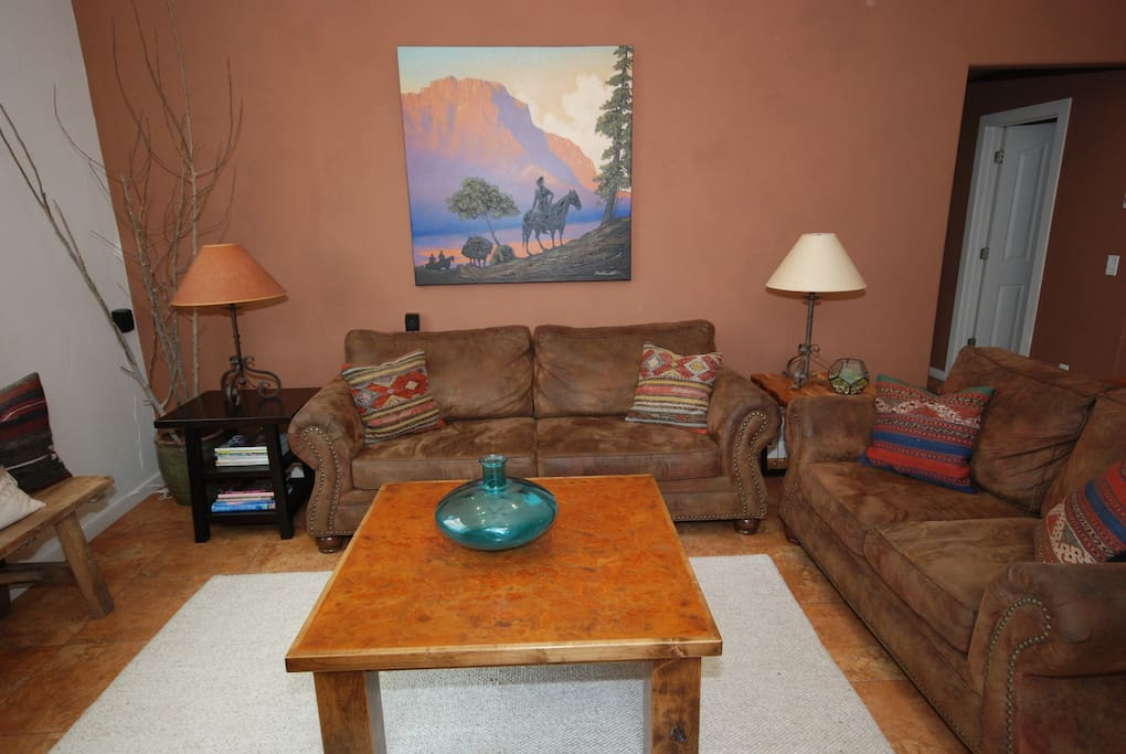 Cozy living room has a sofa and loveseat, fireplace, and flat screen tv with DVD player.