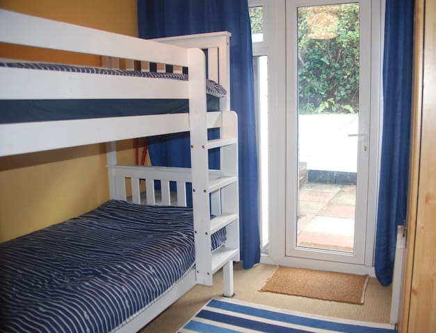 Comfortable Twin bedroom leading to private sheltered patio.