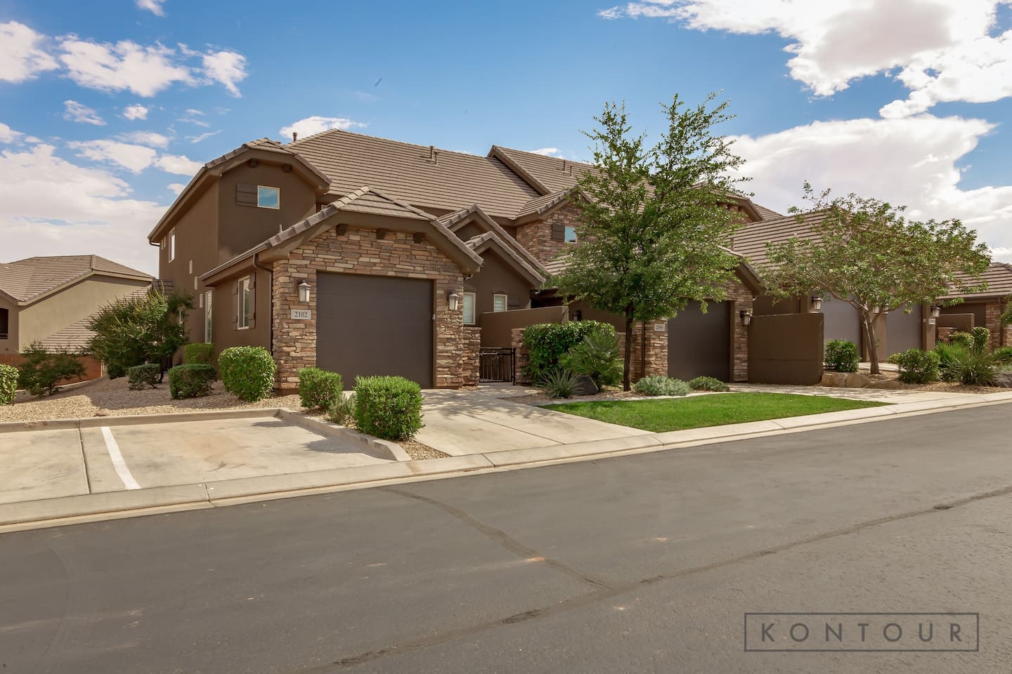 Welcome To 2102 N. Coral Ridge Dr. - FULL COLOR Country Living; End Unit w/Guest Parking Directly To Left Side, TWO Swimming Pools, Spa, Exercise Rm & Clubhouse. Minutes To Zion National Park, Golfing, Red Sands, Water Sports & ALWAYS Blue Skies