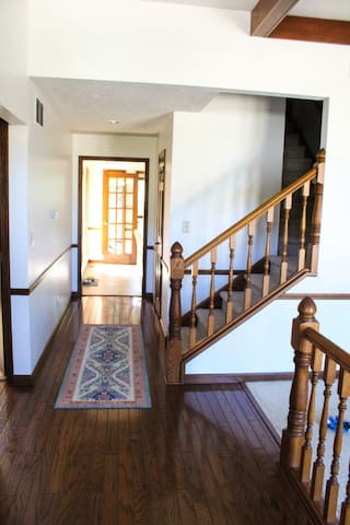 Entryway and staircase to the private upstairs area