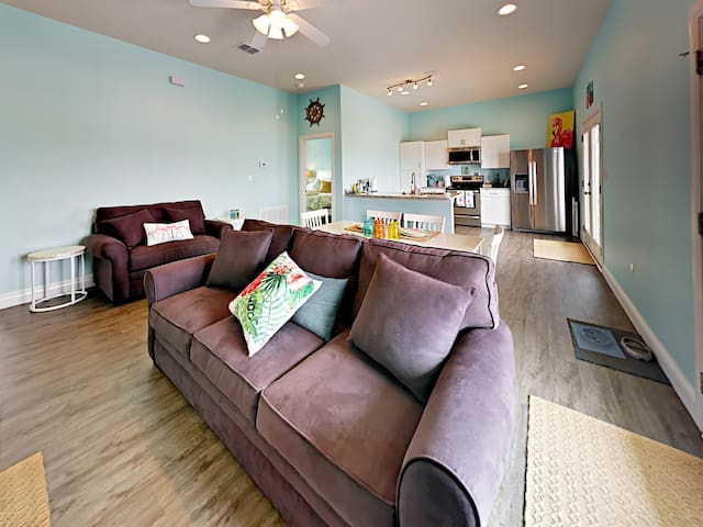 A love seat and sleeper sofa provide comfy seating in the living area.
