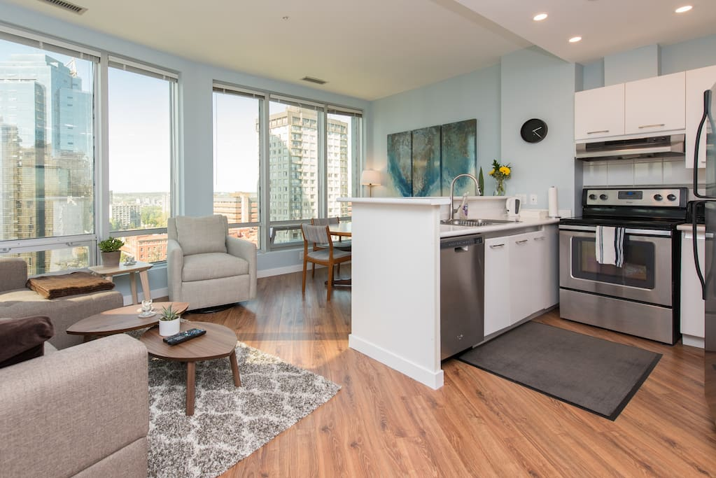 Enjoy spectacular views of Downtown Vancouver from the comfort of your living room :) Large floor-to-ceiling windows emanate plenty of light