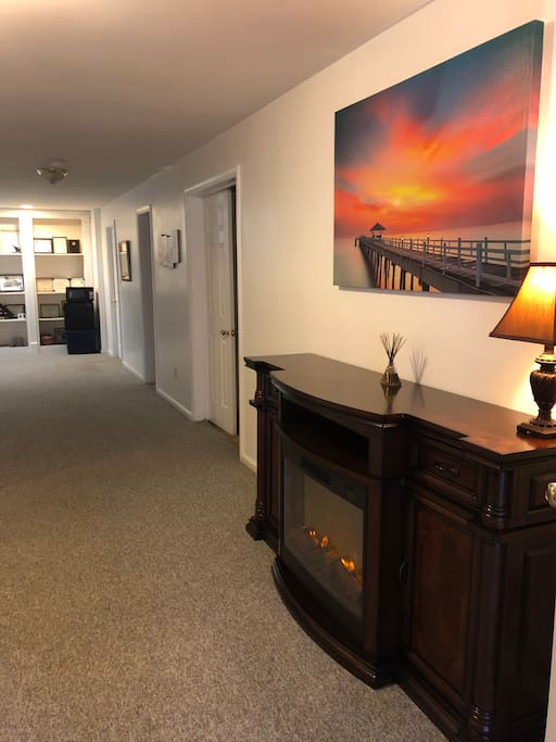 Lower Level Studio Apartment.  Electric fire place and canvas art work are displayed.  Total Privacy.