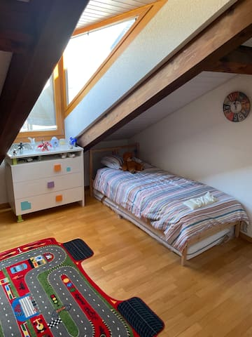 Junior bedroom 2.  Single bed 1m90 long with extra mattress underneath for extra bed.