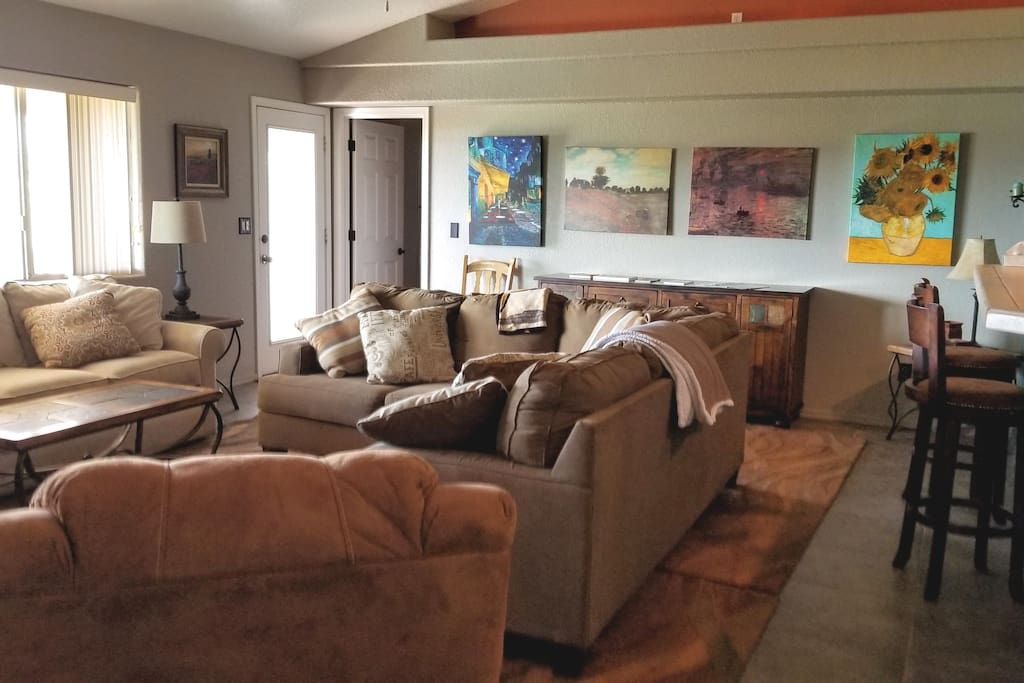 Two large couches and a recliner make living room ideal for friends or family gatherings.