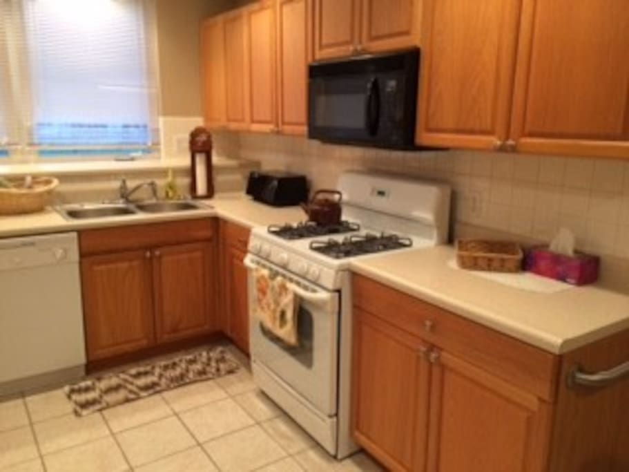 Full kitchen with gas stove, microwave, toaster oven, toaster, dishwasher, refrigerator  & coffee maker