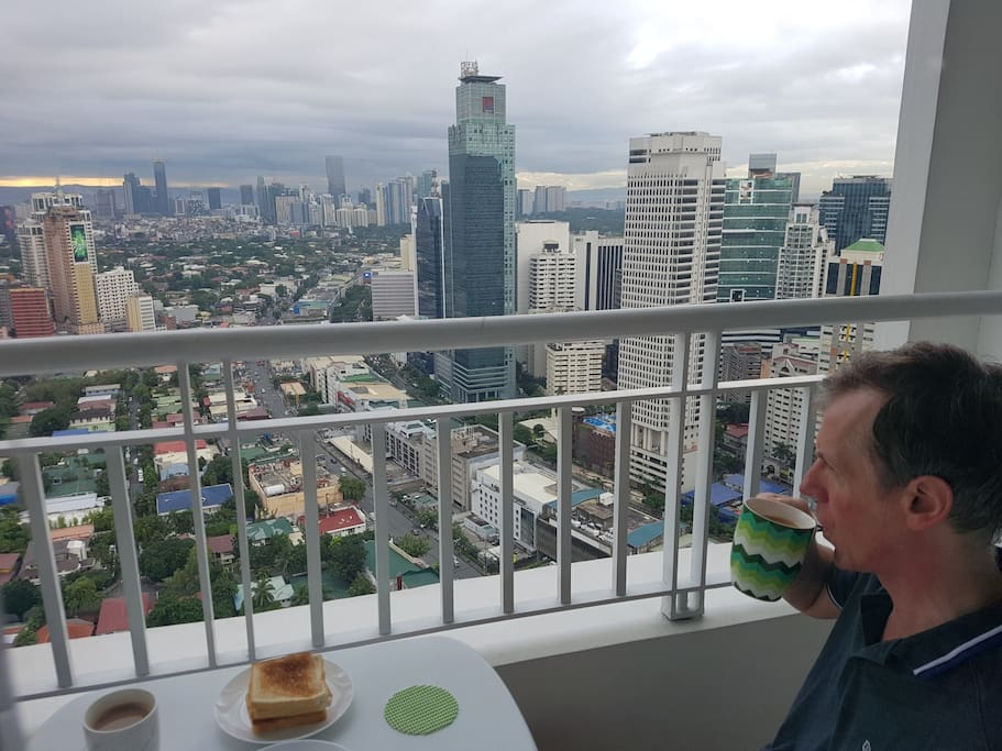 Enjoy breakfast on your balcony overlooking Makati