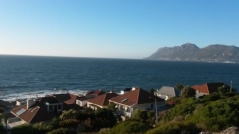 """KALK BAY WITH ITS """"WORKING"""" HARBOR AND A VARIETY OF PLACES FOR FOOD LOVERS TO ENJOY."""