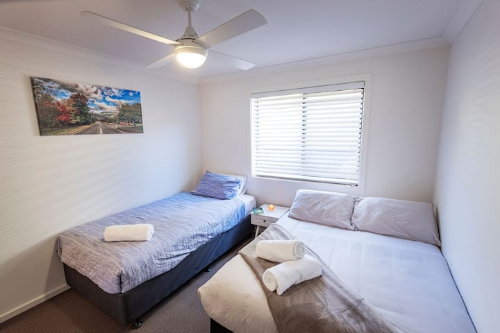 A Double Bed & King Single comfortably sleep 3 in the Second Bedroom