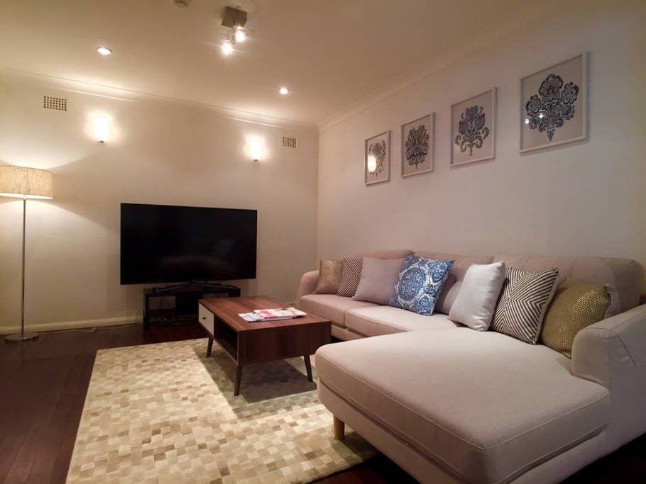 Spacious informal lounge with a large plasma tv for lazy times at home