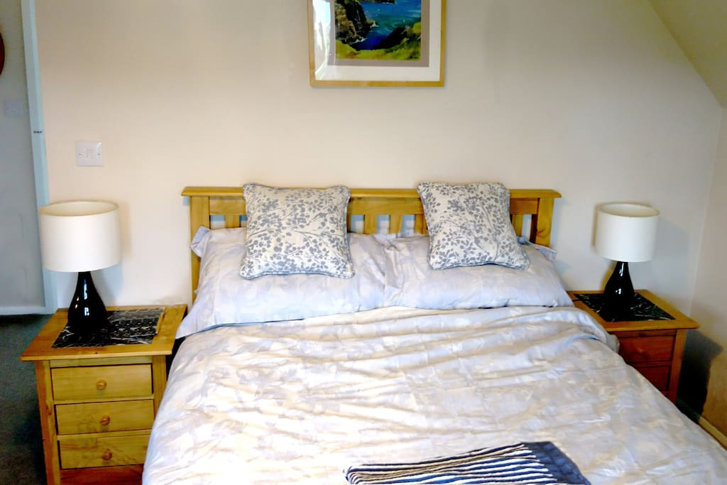 Double bed with view to the hills and sea