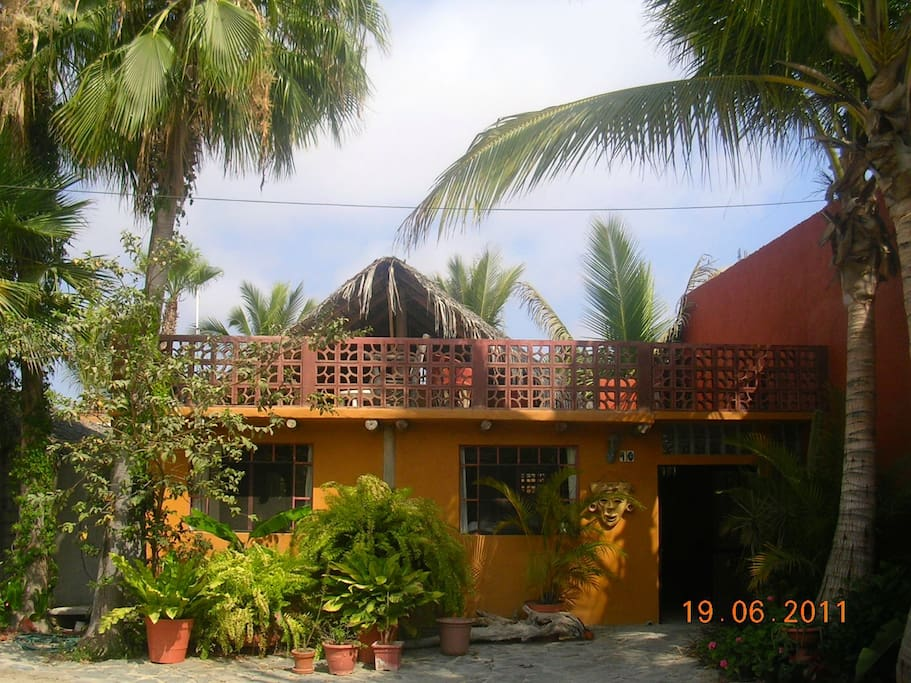 A lovely home built in the Mexican tradition with a palapa roof! Sit on the large deck which has sun and shade all day long!!