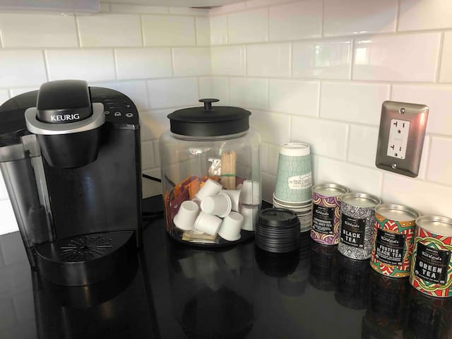 Keurig available with KCups and a variety of teas. There's also a reusable KCup filter if you want to bring your favorite coffee grounds.
