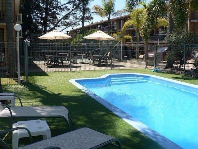 """""""Aquarius Holiday Apartments"""" Corrigans Beach"""